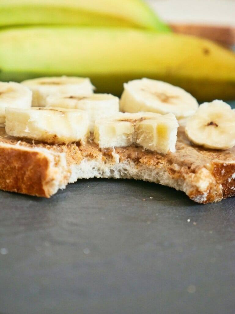 close up of toast with bananas and almond butter