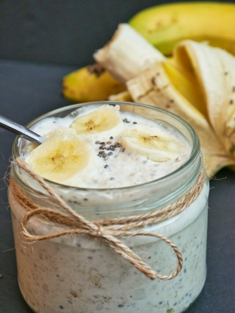 banana overnight oats in a mason jar with bananas