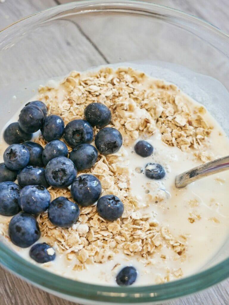 blueberries oatmeal and yogurt in a bowl