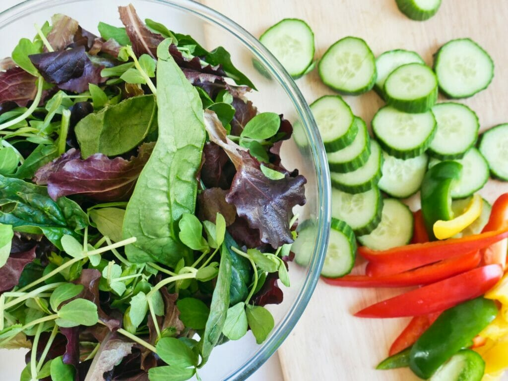 bowl of salad with chopped cucumbers and bell peppers