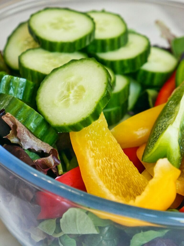 cucumbers and bell peppers in a bowl