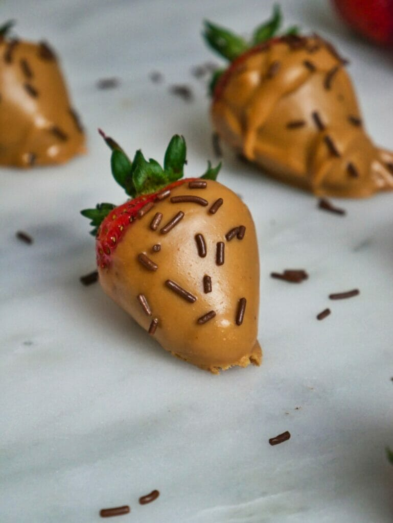 strawberry covered in peanut butter and sprinkles